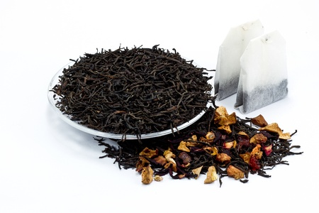 black tea leaves with dried fruit tea on white background photo