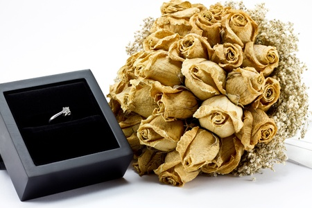 Dried roses bouquet and engagement ring photo