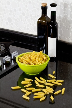 background of modern kitchen and uncooked pasta photo