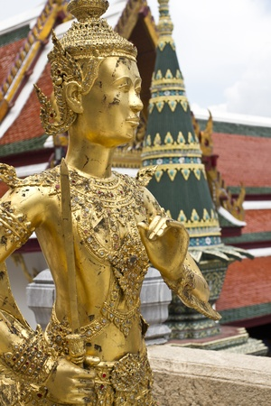 A Golden Kinnari statue  photo