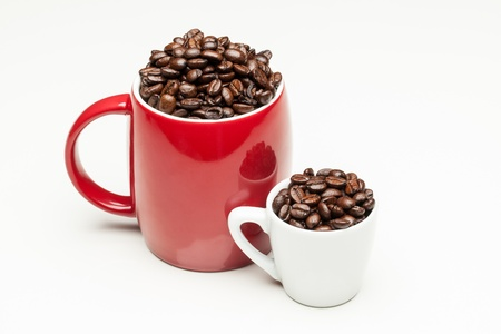 Red and white cups with coffee beans photo