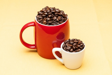 Red and white cups with coffee beans Stock Photo - 13277020