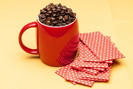 Red coffee cup with napkin photo