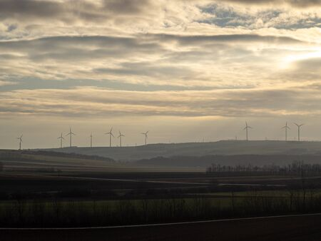 These are windmills at sunset. Stockfoto