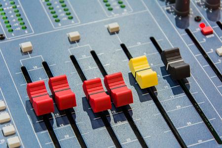 Audio adjust levels control buttons on sound mixer ( shallow depth on field) Stock Photo