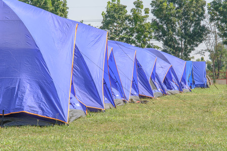 boy scouts tent: A group of canvas tents at a campground at the  Maewong  camp by boy scout camp in Thailand with green grass and tress all around Stock Photo