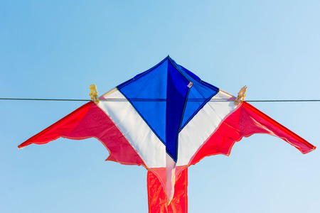 tethered: Thailand flag kite and bat kites against cloudless blue sky Stock Photo