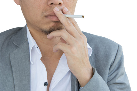 frustrating: stressful businessman smoking an cigarette isolated on white background Stock Photo