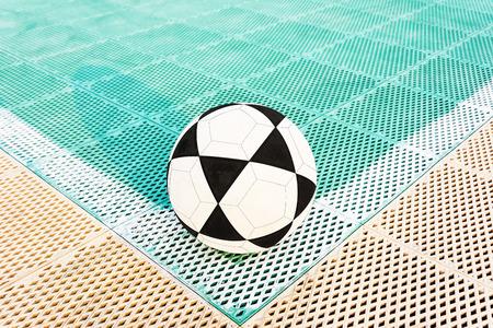 football on the corner of futsal field photo