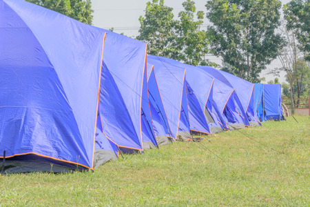 boy scouts tent: A group of canvas tents at a campground at the �Maewong� camp by boy scout camp in Thailand with green grass and tress all around Stock Photo