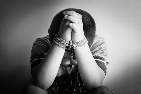 photo of children hand tied, imprison, retarded, Child Abuse in white tone