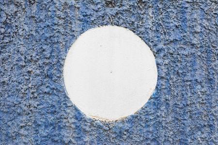 creep: white circle on rough concrete wall