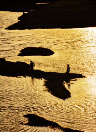 waterless: blurry and silhouette of waterless lake at sunset time. There are some people fishing in lake