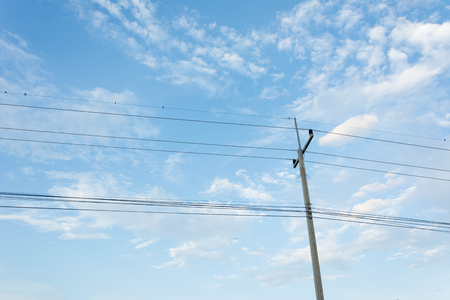 electrical materials: electric pole with lines against blue sky Stock Photo
