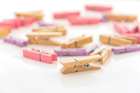 clothespeg: many color of clothespins on white background