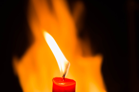 candlelight on  Blazing fire and black background