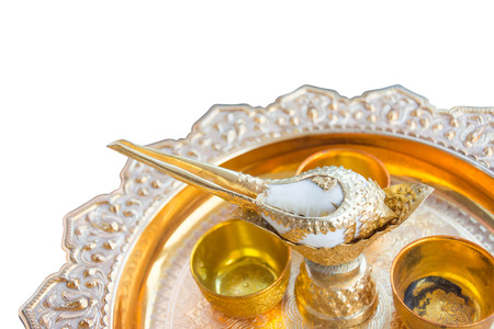 commit: conch shell watering for thai traditional wedding customs isolated on white background
