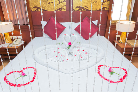 heart suite: Luxury romantic hotel suite room for just married couple with heart shape elements and flowers Stock Photo