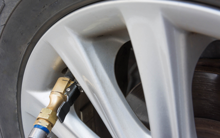 inflate: Inflate car tires Stock Photo