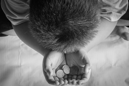 homeless begging boys hand with money Stock Photo