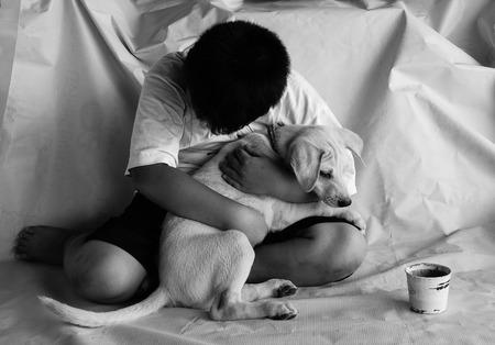 begging: homeless begging boy and dog