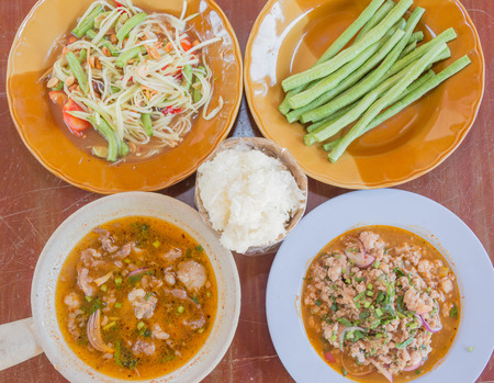 green papaya salad: Thai cuisine ; Spicy Boiled Beef , Spicy minced pork , papaya salad with fresh green long and Sticky rice Stock Photo