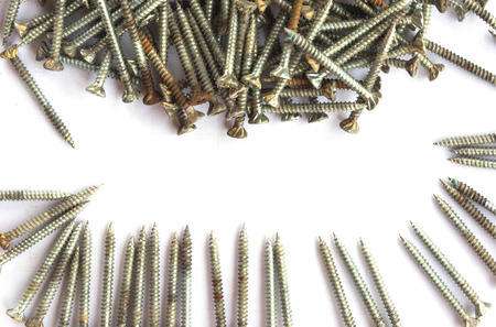 rusty used screws on white background