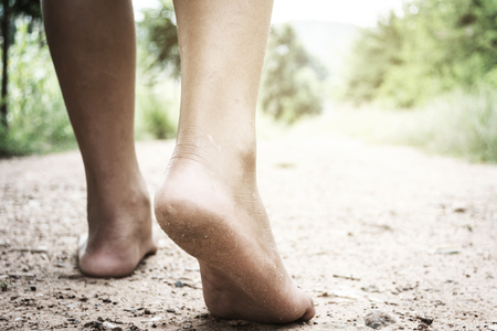 kids walking on bare feet with blurry background, poverty concept Stock Photo