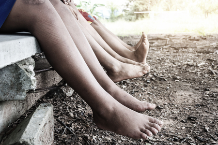 Legs of a kids, Child sitting. concept for concept for family, friends, carefree and vacations Stock Photo
