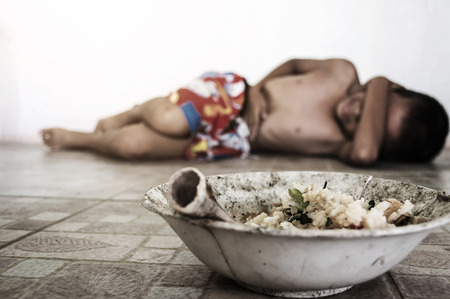 unwashed: Causes of food poisoning, blurry of little boy lay down after eating moldy rotten food on ground with gradient and shadow edge, poverty and lacking concept