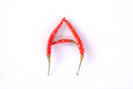 Red hot thai spicy chili alphabet A on white Stock Photo