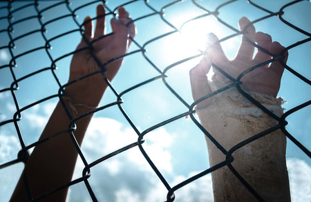 imprisoned: the boy holding the cage with sky background, imprisoned, retarded, Child Abuse