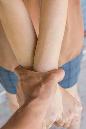 powerfully: mans hand grab aggression womans hands powerfully