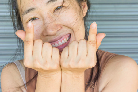 a woman with fingers in heart form, Mini heart,Symbolic of Korea Stock Photo