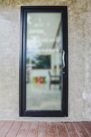 mirror frame: black frame mirror hanging on concrete wall