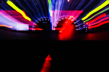 accelerated: abstract motion blur of light with cars Speedometer illuminated