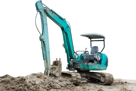 mini loader: A small industrial digger moves earth at field