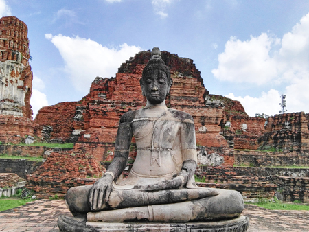 head stones: Ruin of buddha statue  and old temple in Ayudhaya Historical park Stock Photo