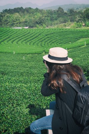 Photograher holding DSLR Camera for shoot photo in Chiangmai ,Thailand