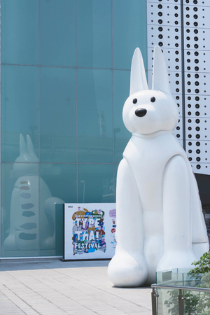 renovated: BANGKOK, THAILAND, FEBRUARY 28, 2017 , dog statue in front of New MBK Shopping, the one of the most popular shopping malls in Bangkok.