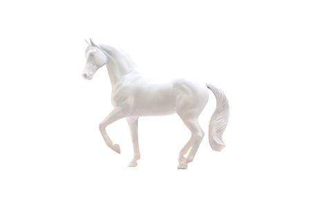 moulding: Statuette of white horse isolated on white.