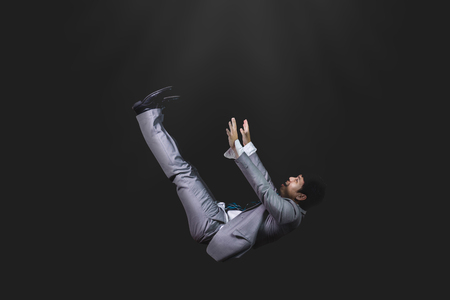 falling and screaming businessman in formal wear