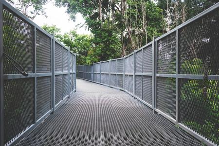 sky walk in forest,metal fence bridge, walk way, Chiangmai, Thailand Stock Photo