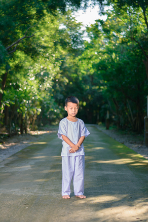kid on white clothing , practice walking Meditation in forest tree with peace in min Stock Photo