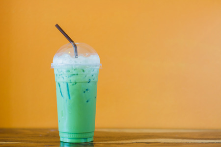 ice milk green tea on table  Stock Photo