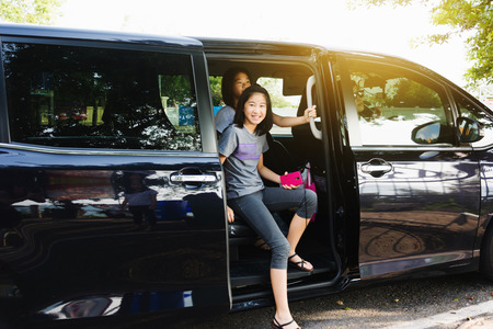 Kids getting out from car when arrive destination