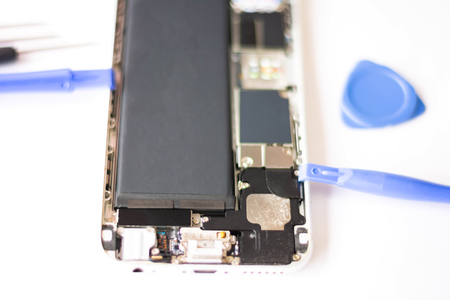 Close-up Of Repairing Cellphone, inside of the phone after open to repair