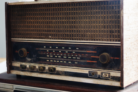 Retro broadcast radio receiver with many button and playiner volume knob