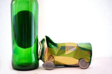 Aluminium Beer can crash on Beer bottle, dangerous of car accident concept