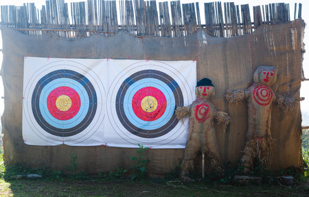 shooting target on bamboo wall with Straw puppet